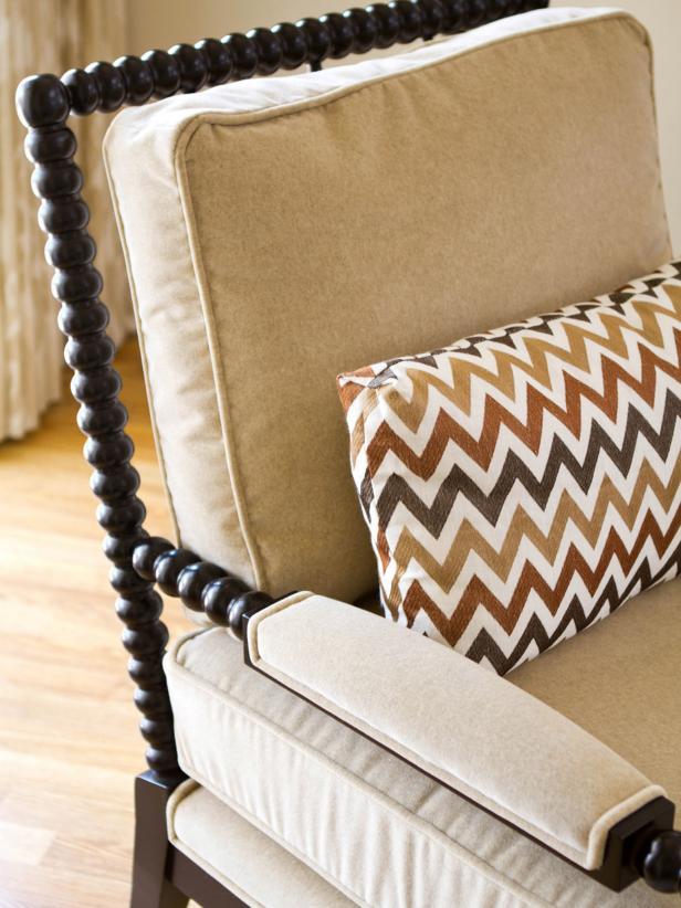 Wood Bobbin Chair With Neutral Cushion and Chevron Pillow