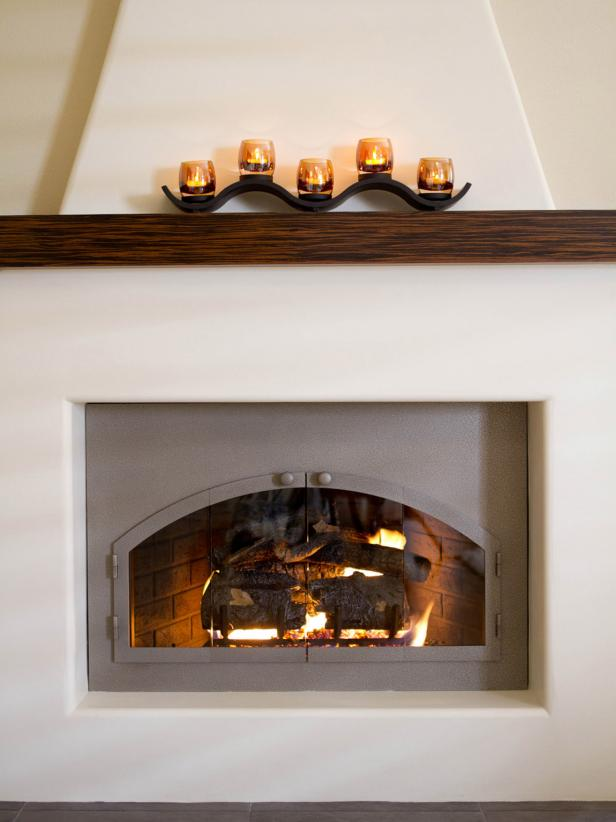 White Adobe Fireplace With Gas Logs and Wood Mantel