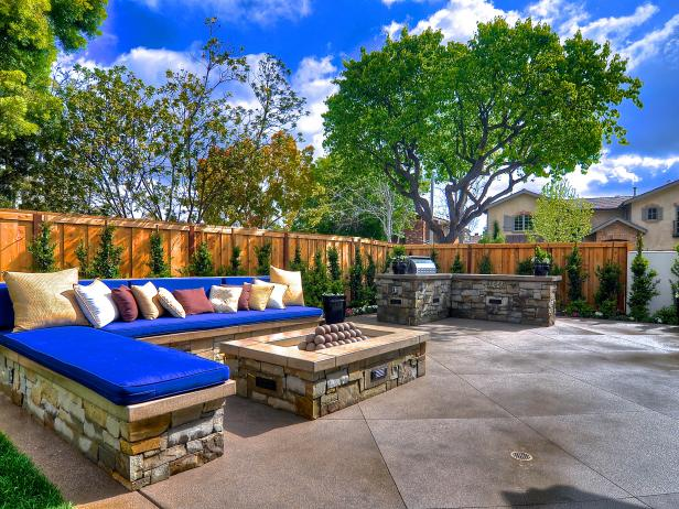 Backyard Patio with Built-In Fire Pit, Stone Benches and Blue Cushions