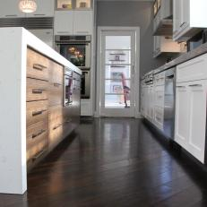 Dark Hardwood Floors Set Off White Cabinets In This Transitional Kitchen