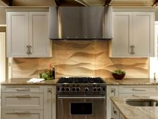 Neutral Kitchen With Wolf Range, Limestone Backsplash