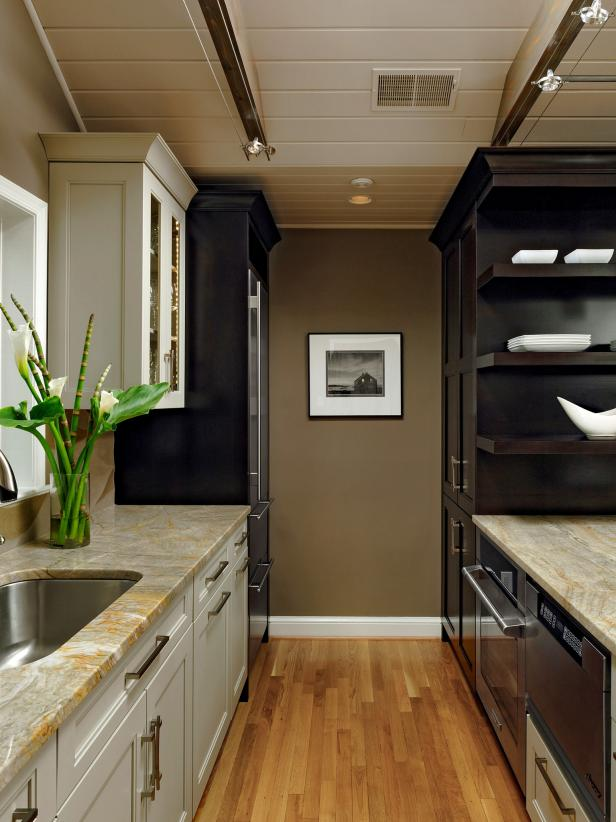 Galley Kitchen With Black and White Cabinets
