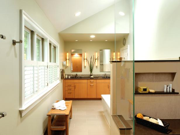 Neutral Modern Master Bathroom with Wood Cabinets and Glass Shower
