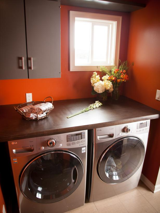 orange laundry room with wood-door countertop