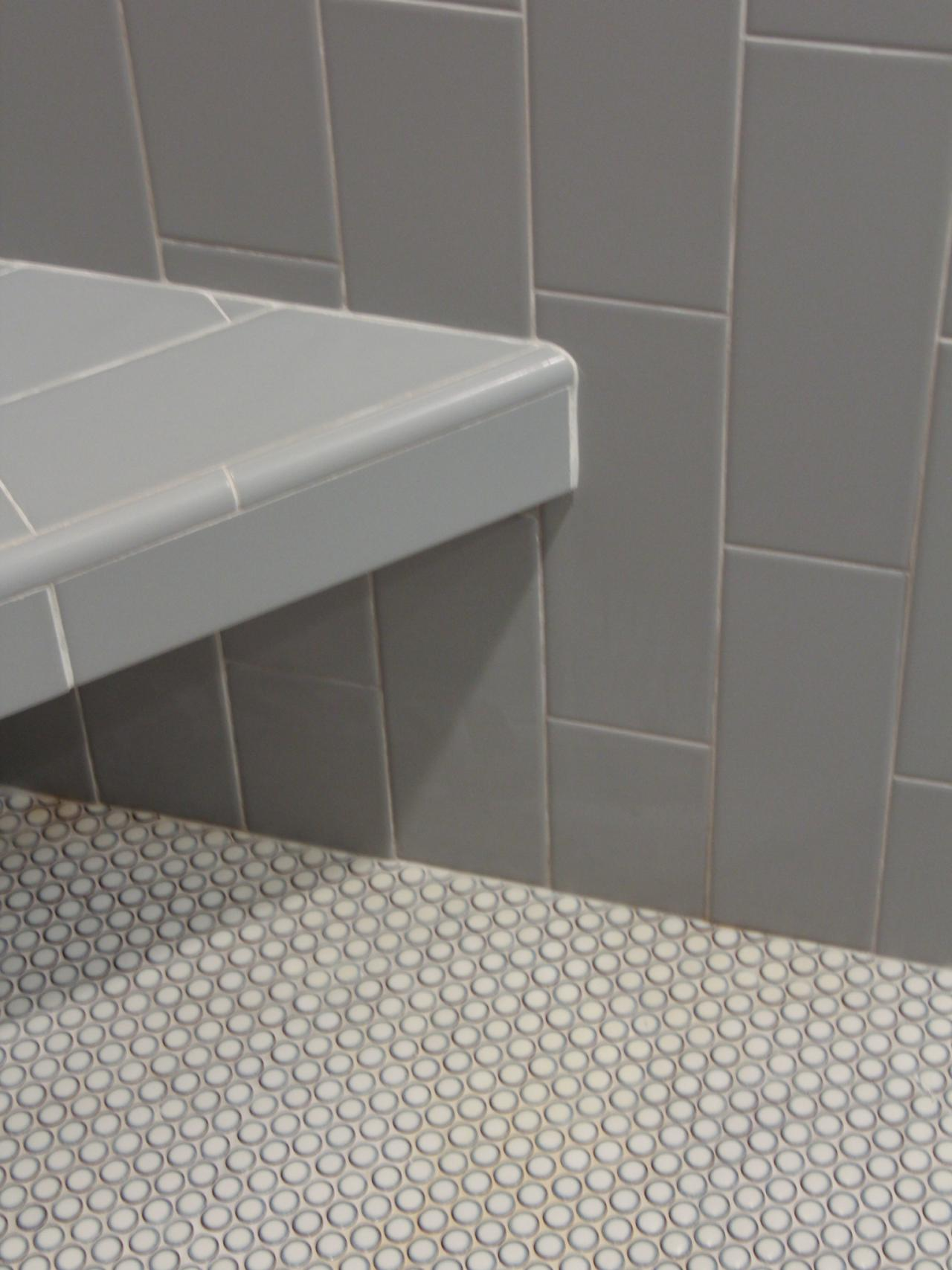Shower Featuring Gray Subway Tile And Penny Mosaic Floor Tile