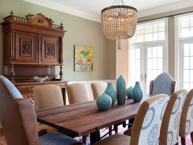Transitional Green Dining Room With Dramatic Chandelier
