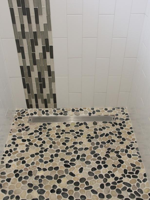 Neutral and Black Mosaic Pebble Shower Pan