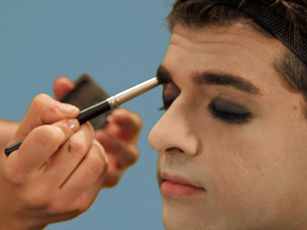 To intensify the dark, masculine nature, use the rounded brush and a little gray eye shadow to shade the inside of your eyes up to your eyebrows.