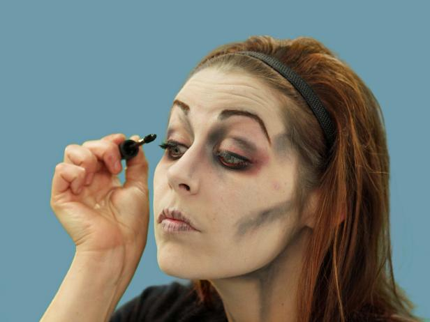 After applying eye liner and eye shadow, complete your zombie eye by adding mascara in a haphazard manner.