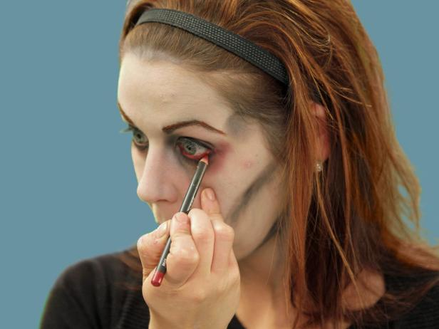 For the perfect undead zombie eyes, add red eye liner to the water line of the eye. This will make the eyes appear tired and sickly.