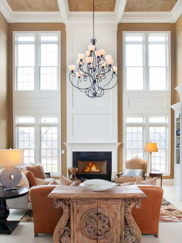 Neutral Transitional Two-Story Living Room With Fireplace & Chandelier