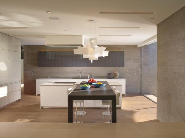 Modern neutral kitchen with artistic suspended light fixture