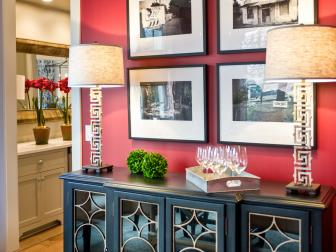 Eclectic Red Foyer with Decorative Black Cabinet