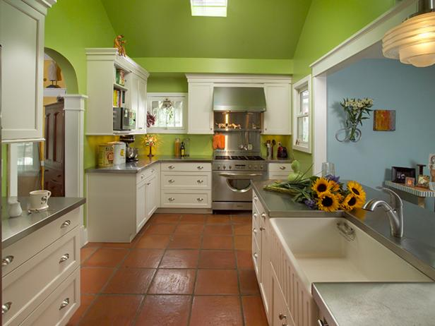 Green Kitchen With White Cabinets and Stainless Steel Countertops
