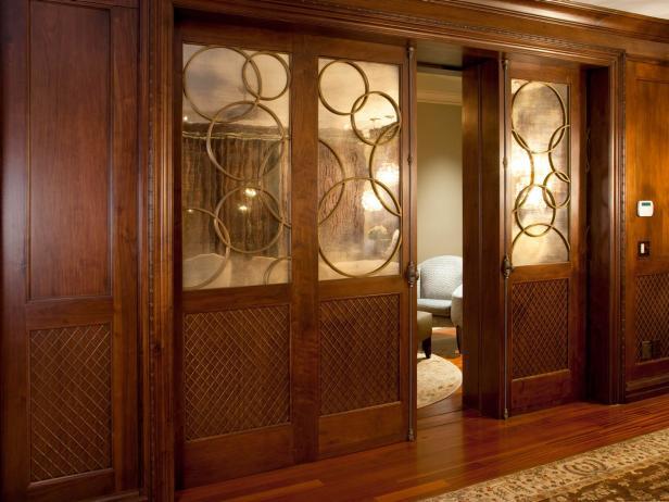 Wooden Pocket Doors With Geometric Design in Master Bedroom