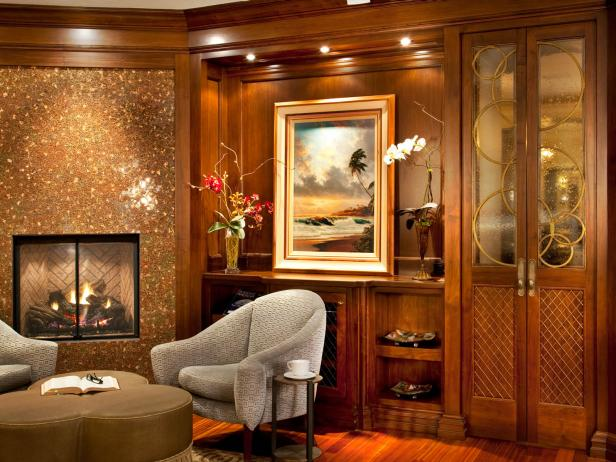 Cozy Sitting Area With Wood Paneling and Fireplace