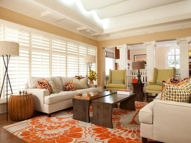 Warm Transitional Living Room With Plantation Shutters