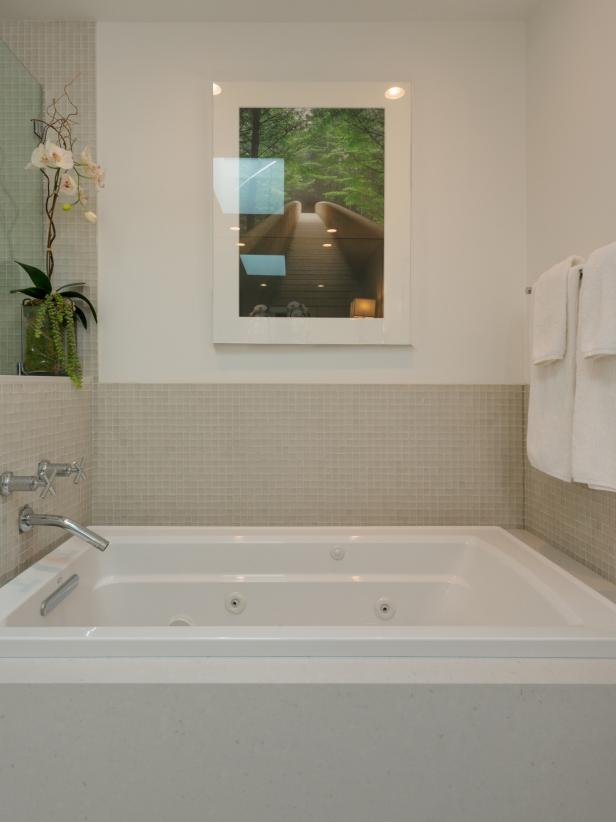 White Soaking Tub in Neutral Bathroom