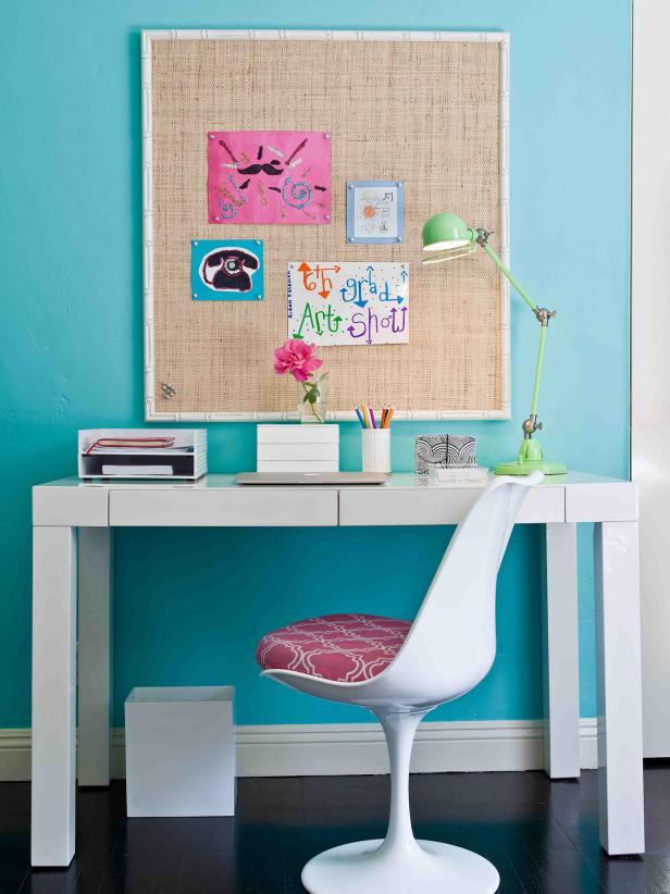 Blue Teen Study Nook With White Desk and Tulip Chair