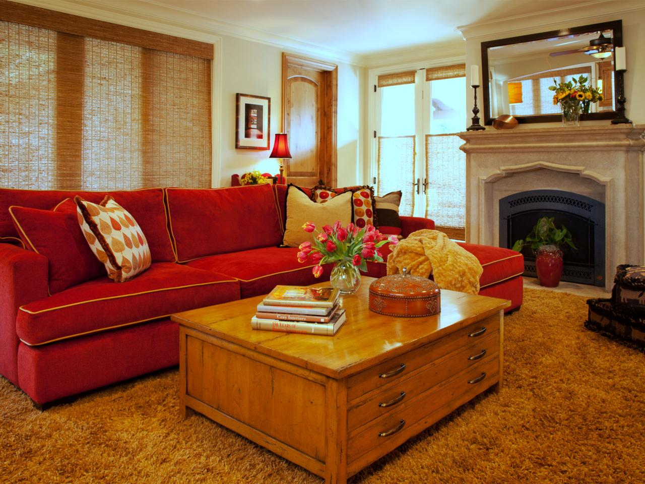 neutral transitional living room with red sofa a red sofa adds color
