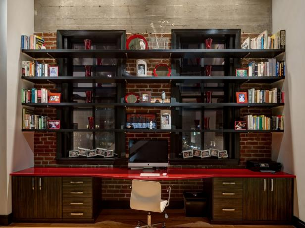 Wall-to-Wall Desk With Red Countertop, Black Shelves & Exposed Brick