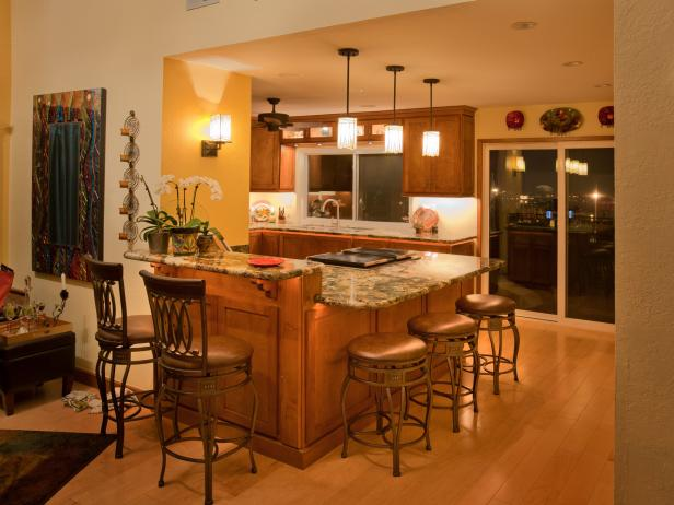 Eat-In Kitchen With Wood Island, Pendant Lights and Swivel Barstools