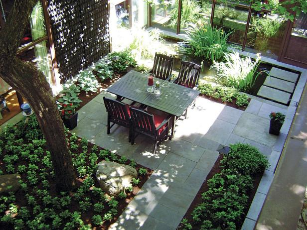 Courtyard With Wood Dining Set, Shade Tree and Bluestone Walkway