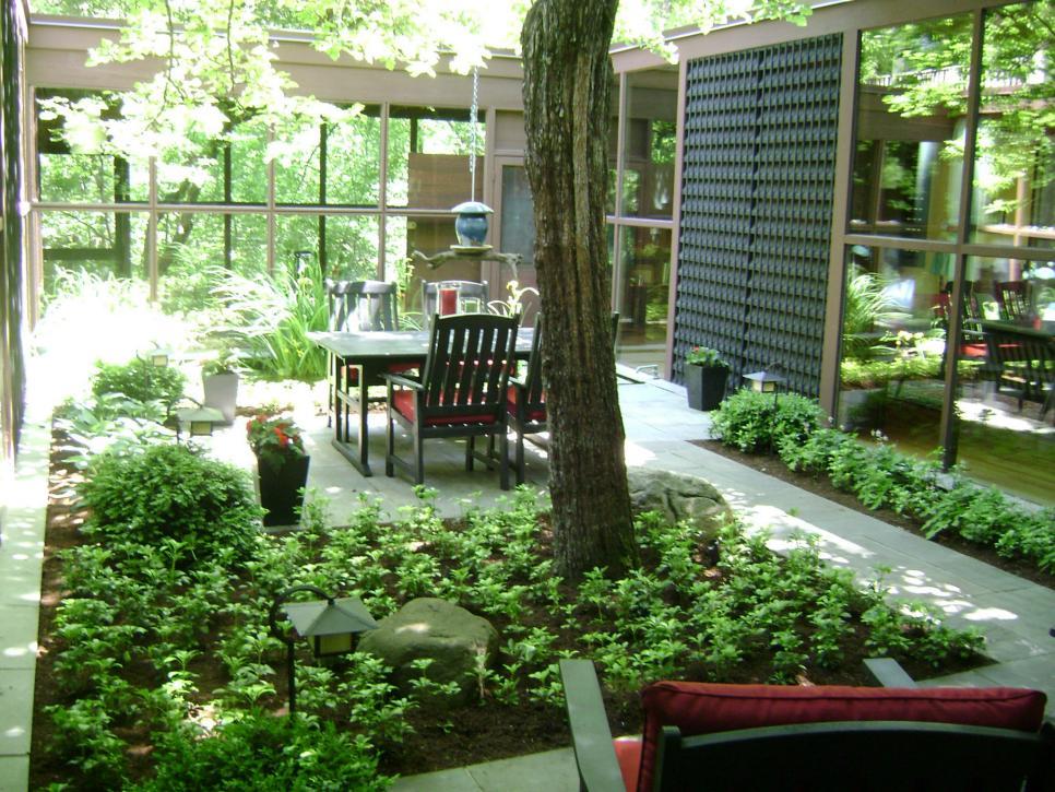 Lifeless courtyard gets a fresh start james bertrand hgtv for Hgtv landscaping