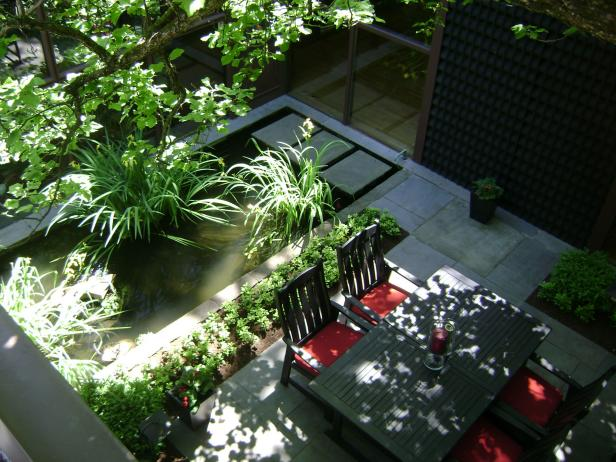 Aerial View of Stone Patio With Rectangular Pond & Dining Table