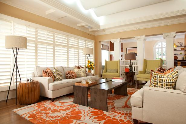 Living Room With Orange-and-Cream Rug, Neutral Sofas and Green Chairs