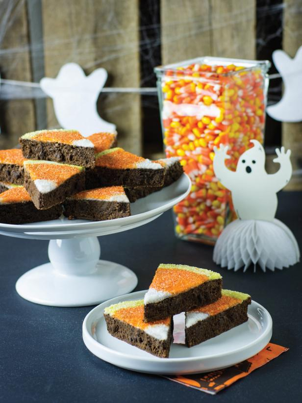 Candy corn gets a new look with these fun Halloween brownies. They are as pleasing to the eye as they are to the palate. Serve on a dessert table with jars filled with real candy corn.