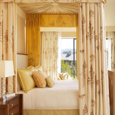 Canopy Bed With Cream & Floral Drapes