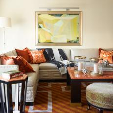 Contemporary Seating Area with Warm Rust-Colored Rug