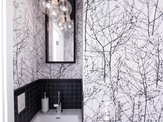 Black and White Powder Room With Bold Wallpaper