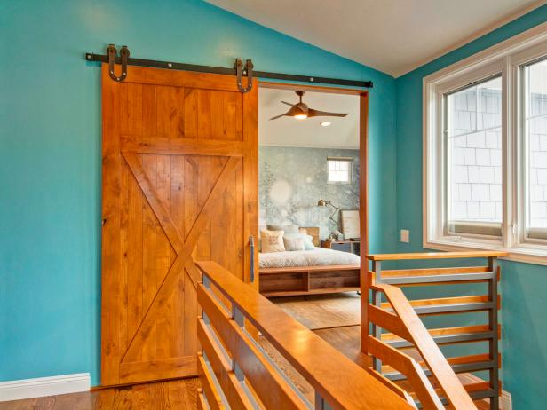 Turquoise Hall With Sliding Barn Door to Master Bedroom