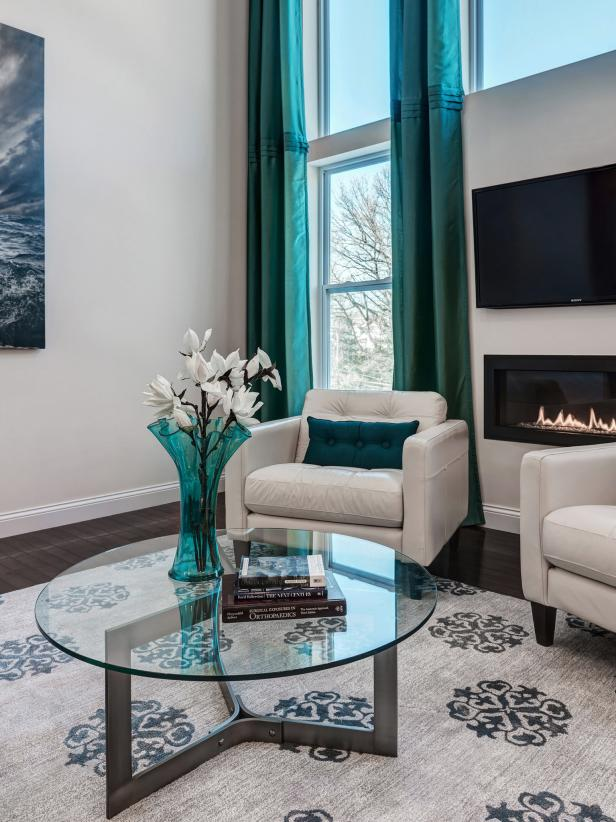 Contemporary Living Room With Turquoise Drapes and Wall Fireplace
