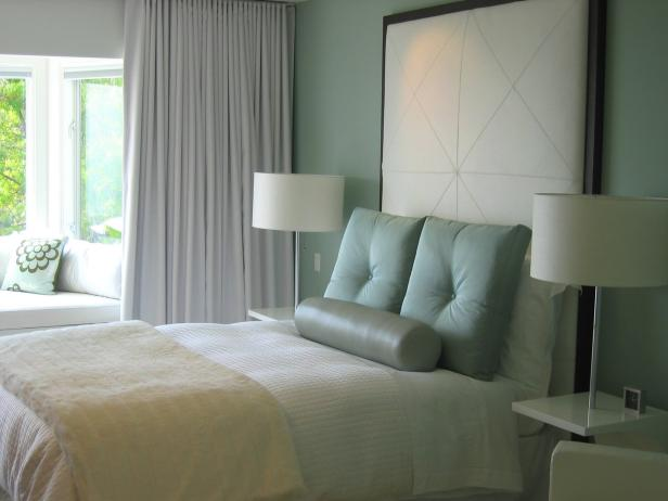 Pale Blue Bedroom With Tall White Headboard and White Bedding