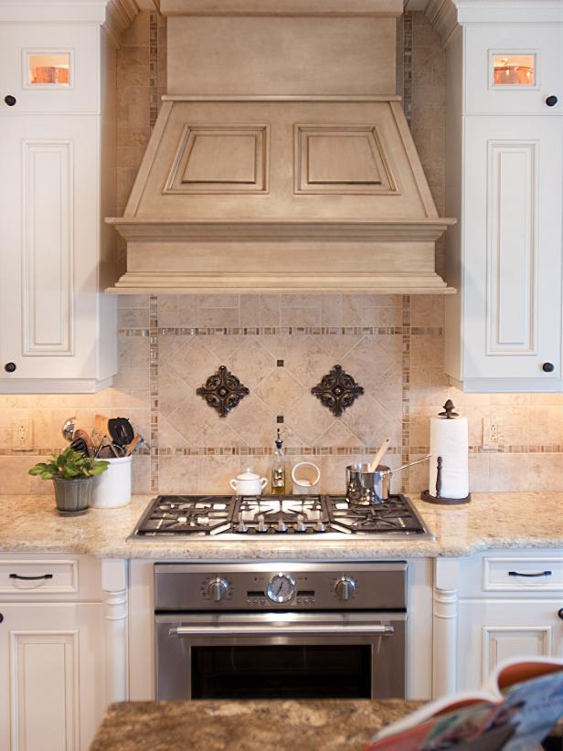 Mediterranean Kitchen With Elegant Range Hood and Backsplash