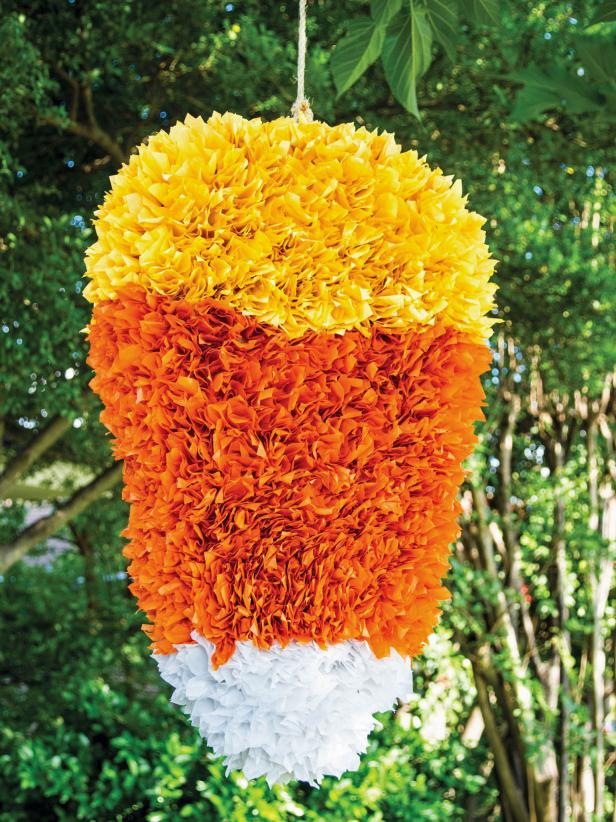Halloween swings into action with this candy corn piñata. Your party guests will love taking a shot at this treat-filled craft. Because you make it yourself, you get complete control over what goes inside.