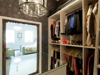 Walk-In Closet With Shelving and Mirrored Table