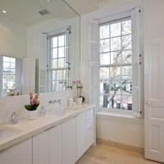 White Bathroom With Plantation Shutters