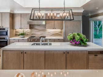 Elegant, Contemporary Kitchen With Light Cabinetry and Industrial Chandelier