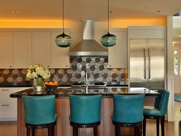 Kitchen With white Cabinets, Metallic Backsplash and Teal Barstools