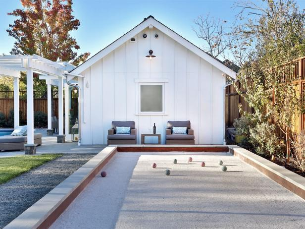 Bocce Ball Court in Backyard With Pool and Outdoor Kitchen