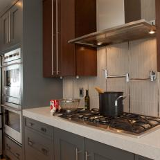 vertical backsplash tile with stainless steel inserts