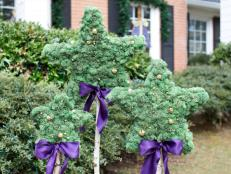 Holiday Star-Shaped Topiaries With Bells and Bows