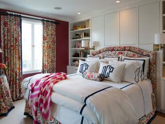 Bold Red Traditional Bedroom With Floral Curtains