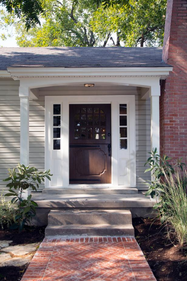 A Fixed Up Home With Dark Dutch Front Door