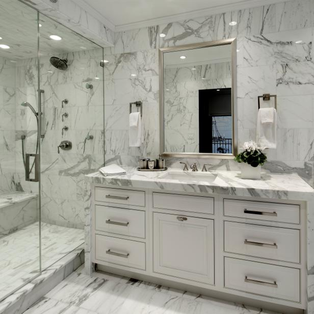 White Marble Bathroom With Glass Walk-In Shower