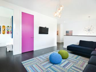 Modern Family Room With Bright Pink Door
